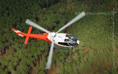 Hélicoptère EC-120 NHE survolant la forêt